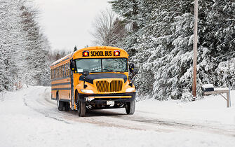 School bus driving in harsh conditions.