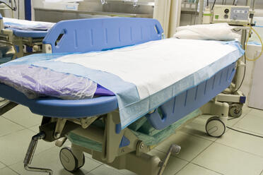 Photo of medical bed in modern hospital